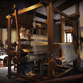 weaver at Quarry Bank Mill by Caroline Beaumont - People Professional People ( weaver at quarry bank mill )