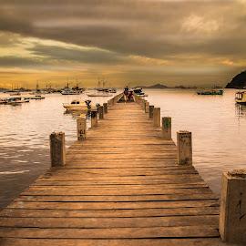 Pier by Nugroho Adi Saputro - Buildings & Architecture Bridges & Suspended Structures ( boats, sea, ocean, travel, beach, morning, dock, island, adventure, traveling, flores, indonesia, cloudy, cloud, pier, sunrise )