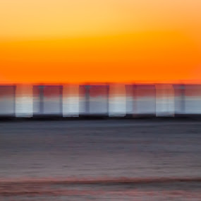 Transparent beach cabines at the seashore. by Roger Hamblok - Landscapes Beaches ( abstract, water, sand, orange, waves, dune, sea, yellow, beach, seascape, landscape, cabine, coast, nature, blue, wave, grey, sunshine, air, gold, view, transparent, golden, golden hour,  )