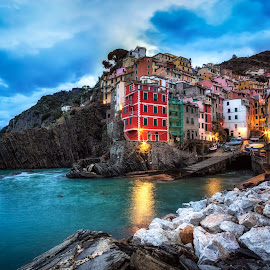 twilight hours in riomaggiore by Aaron Choi - Landscapes Travel ( famous, riviera, cinque terre, italian, europe, colorful, ocean, travel, architecture, beach, coastline, coast, dock, city, village, trail, homes, italy, twilight, riomaggiore, tourism, architectural detail, morning, coastal, landmark, winter, european )