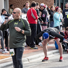 Sick in The Street by Thomas Shaw - Sports & Fitness Running ( lycra, shoes, pants, street, run, raleigh, north carolina, hat, krispy kreme challenge, vomit, shorts, sick, men, head, man, shaved head, sidewalk )