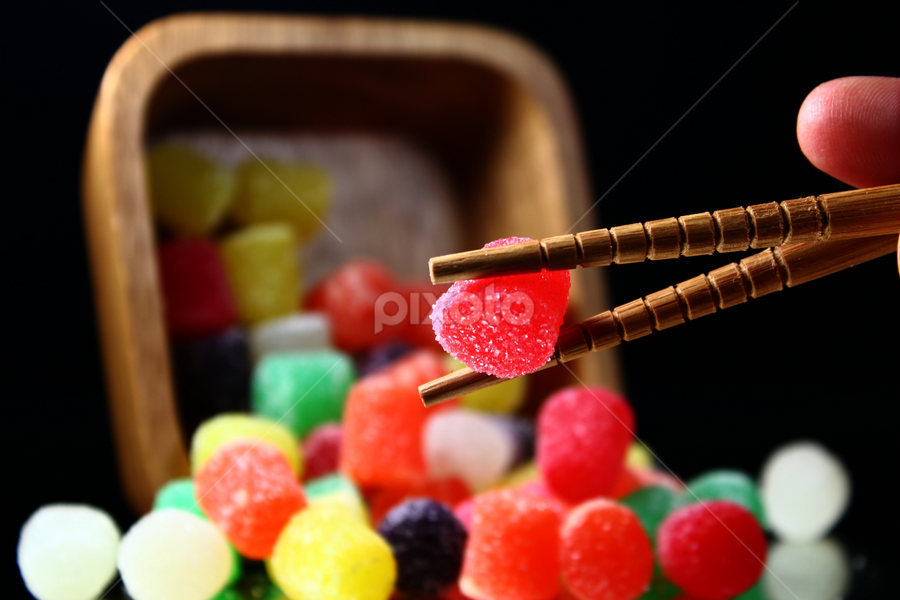 Candy. by Dipali S - Food & Drink Candy & Dessert ( cook, foodie, breakfast, nomnom, yummy, kids, chop stick, dinner, black background, tasty, sweet, groceries, candy, fallen, food, family, cooking, eat, lunch, hungry, dessert,  )