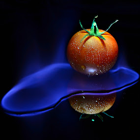 crematomatorium by Angelo Jadulco - Food & Drink Fruits & Vegetables ( burned, plant, water, orange, fruit, reflection, tomato, dew, angelo jadulco, fire, blue flame, flame, ainjelography, black background, ingredients, red, blue, food, wet )
