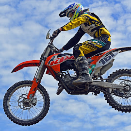 Flying Like A Bird by Marco Bertamé - Sports & Fitness Motorsports ( clouds, orange, white, number, yellow, race, jump, 161, flying, sky, motocross, blue, one hundred sixty-one, air, alone, competition )