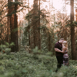 Warmth by Kate Gansneder - People Couples ( montana, sunset, engaged, forest, couple )