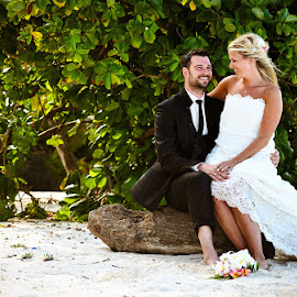 Love on a  log by Andrew Morgan - Wedding Bride & Groom ( love, zanzibar, wedding, beach, bride, groom )