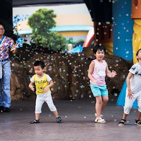 Children with bubbles by Tony Mortyr - City,  Street & Park  Amusement Parks ( bubbles, children, china )