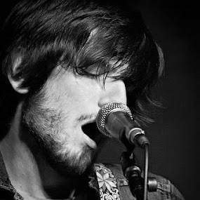 Dean Tartaglia of Mind Fish (B&W) by Josh Mayes - People Musicians & Entertainers ( jacket, jean, strap, microphone, b&w, singing, fish, lead, singer, stripes, portrait, band, mic, dean, sing, beard, guitar, mind, hair, tartaglia )
