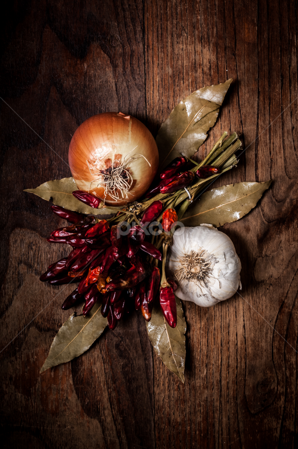composition of chilies, onion and garlic by Eugenio Marongiu - Food & Drink Ingredients ( raw, aroma, aromatic, garlic, wood, cuisine, pepper, spices, macro, seasoning, dried, cooking, vegetarian, ingredient, chilli, gourmet, onion, clove, white, spicy, table, bio nutrion, kitchen, chili, vegan food, biologic, vegan, bio food, nutrition, organic, wooden, red, bio, laurel, herb, food, crushed, background, condiments, ripe, eating, hot, natural, raw food )