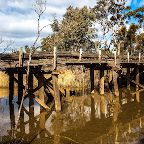 Old bridge going back to the early 1900's Wimmera. Australia. by Lynton Brown - Buildings & Architecture Bridges & Suspended Structures ( water, wood, old. lynton brown, bridge )
