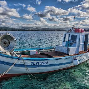 Fishing boat by Maurizio Mameli - Transportation Boats ( clouds, sky, sardinia, cloud, sea, seascape, fishing, landscape, boat, italy, fishing boat, array )