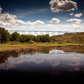 Reflection of the Lethbridge Viaduct by Jeffrey  Thur - Landscapes Waterscapes