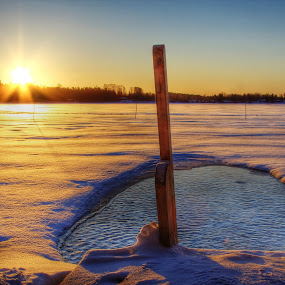 Ice pool in a Finnish lake by Simon Lambert - Artistic Objects Other Objects ( finland, lake, sunrise, frozen, ice pool )