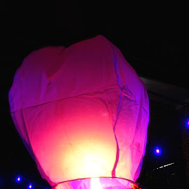 Lantern about to make its journey. by Satyajit Tambe - Novices Only Objects & Still Life ( hot air, lantern, night photography, night, street scene, balloon, lanterns, street photography, flame, colours )