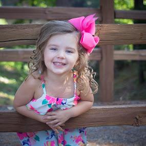 by April Sadler - Babies & Children Child Portraits ( #child #park #smile #fence #happy #bow )