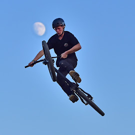 Playing With The Moon ! by Marco Bertamé - Sports & Fitness Other Sports ( flying, moon, sky, bike, blue, air, high, bicycle )