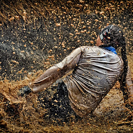 Inbetween The Brown Shower by Marco Bertamé - Sports & Fitness Other Sports ( water, splatter, splash, differdange, 2015, soup, luxembourg, muddy, sitting, strong, woman, lady, brown, strongmanrun )