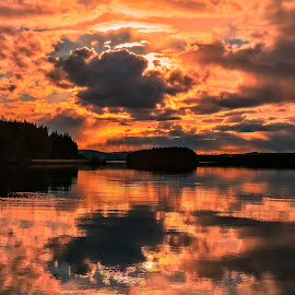 Eveninglight by Ewa Nilsson - Landscapes Weather ( water, clouds, reflection, lapland, sunset, trees, forest, light )