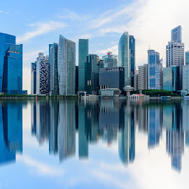 Singapore city skyline of business district downtown in daytime. by Nuttawut Uttamaharach - Buildings & Architecture Office Buildings & Hotels ( skyline, reflection, centre, exterior, travel, architecture, cityscape, landscape, business, singapore, city, center, modern, daytime, skyscraper, riverside, asia, marina, district, light, reflective, downtown, water, hipster, building, format, landmark, urban, bay, horizontal, outdoor, scenery, day, natural, waterfront, outside, daylight, reflect, river )