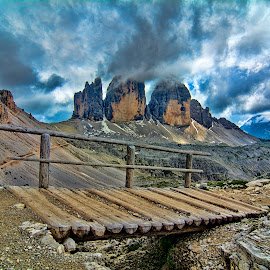 Bridge to Tre Cime by Steve Rogers - Landscapes Mountains & Hills ( clouds, trail, avalon-art, cloudscape, wood bridge, storms, dolomites, bridge, trails, storm, peaks, tre cime )
