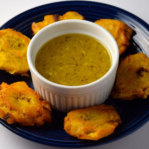 Tostones (Fried Plantains) with Mojo (Garlic Sauce)