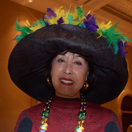 Lady in Black Hat with Mardi Gras Feathers by Monique Littlejohn - People Portraits of Women ( feather hat, black hat, wide brimmed hat, mardi gras, stunning lady in hat )