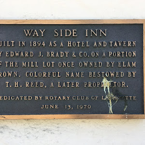 WAY SIDE INN BUILT IN 1894 AS A HOTEL AND TAVERN BY EDWARD J. BRADY & CO. ON A PORTION OF THE MILL LOT ONCE OWNED BY ELAM BROWN. COLORFUL NAME BESTOWED BY T. H. REED, A LATER PROPRIETOR. DEDICATED BY ...