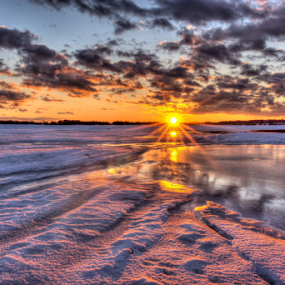 by Blaine Stauffer - Landscapes Sunsets & Sunrises ( clouds, water, ice, sunset, snow )