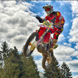 Hot Jump by Marco Bertamé - Sports & Fitness Motorsports ( clouds, wheel, speed, green, number, yellow, race, noise, jump, 12, flying, red, motocross, blue, cloudy, grey, air, high )