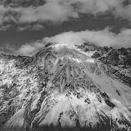 Snow Caped Mountains by Ansari Joshi - Black & White Landscapes ( clouds, black and white, kazbegi, cloudscape, georgia, beauty in nature, caucasian, mountains, winter, must see places, snow, snowcaped, travel photography, travel locations,  )