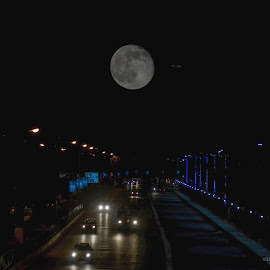 Higher Light by Suman Basak - City,  Street & Park  Night ( moon, sky, blue, street, night, transportation, fast, light )