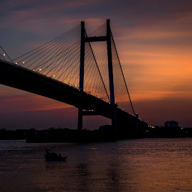 A Colorful Evening by Atin Saha - Buildings & Architecture Bridges & Suspended Structures ( orange, sky, colorful, kolkata, sunset, d5100, evening, river )