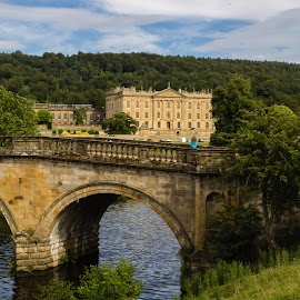 Entering the Estate by Marc Steele - Buildings & Architecture Other Exteriors ( clouds, countryside, uk, grass, house, sun, rural, country, field, england, sky, blue sky, chatsworth, outdoors, trees, derbyshire, estate )