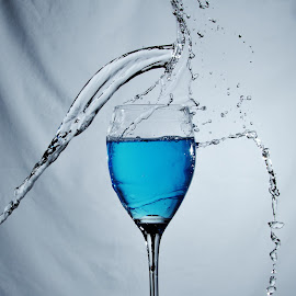 Blue glass and water by Peter Salmon - Artistic Objects Glass ( splash, blue, pour, glass, wet )