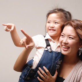 mom & daughter by Woo Yuen Foo - People Family