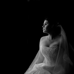 Bride is looking at the window by Kira Likhterova - Wedding Bride