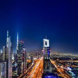 Dubai Skyline by Karim Eldeghedy - City,  Street & Park  Skylines ( skyline, night photography, dubai, long exposure, cityscape, trails, burj khalifa, nightscape, city at night, street at night, park at night, nightlife, night life, nighttime in the city )
