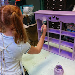Painting the shelves for her 'American Girl' house