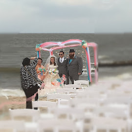 Photographing a Beach Wedding (with Tilt-Shift Effect) by Eric Michaels - Digital Art People ( chairs, windy, beach, people, women, manipulation, tilt-shift, matron of honor, canopy, wedding, photographer, best man, men, surf, bride, groom,  )