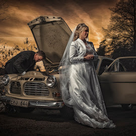 Car problems at the wedding day by Jan Kraft - Wedding Bride & Groom ( car, sweden, brode, nature, dress, waiting, sunset, volvo, amazon )