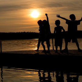 Happy family by Dominic Thibeault - People Family ( backlight, camping, children, lake, sun )