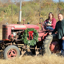 Christmas At The Farm by Christy Stanford - People Couples ( canine, animals, dogs, woman, christmas, wreath, tractor, man, country )