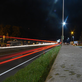 Highway in Austria by Ivan Mendes - Transportation Roads ( lights, exposure, trucks, red, highway, grass, dark, night, road, austria )