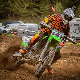 Drifting Trough The Curve by Marco Bertamé - Sports & Fitness Motorsports ( curve, speed, green, number, yellow, race, noise, red, motocross, difting, dust, clumps, brown, 141 )