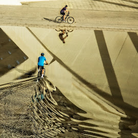 Ripples and Reflections by Stan Lupo - City,  Street & Park  Street Scenes ( water, angles, valencia spain, bicycles, leading lines, city of arts and sciences, ripples, reflections, shadows,  )