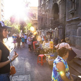 Outside the Basilica by Alejo Cedeno - City,  Street & Park  Street Scenes ( street, travel, documenting, commerce, sun, contrast, religion, chile, merchants, curious, visiting, tourists, checking out, selling, church, glare, walking through, basilica, street photography, panama, facade, items, rosary, santiago, flare, religious )