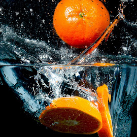 Orange by Eric David - Food & Drink Fruits & Vegetables ( haute vitesse, couleurs, eau, collision, water drop )