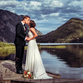 Hereafter by Bendik Møller - Wedding Bride & Groom ( clouds, water, reflection, mountain, ocean, landscape, fjord, kiss, mountains, sky, nature, wedding, flowers, bride, groom )