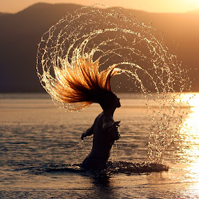 Carefree in the sun and sea by Manny Zervos - People Portraits of Women