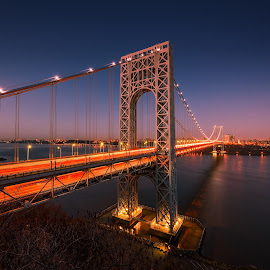 The George Washington Bridge spanning the Hudson River at twilig by Jan Gorzynik - Buildings & Architecture Bridges & Suspended Structures ( reflection, arch, colorful, jersey, transportation, architecture, nyc, travel, landscape, usa, transit, hudson, city, washington, sky, nature, nighttime, york, hudson river, water, structure, connection, park, national, beautiful, suspension, scenic, new york, steel, morning, dusk, george, george washington bridge, landmark, new, blue, sunset, outdoors, night, bridge, infrastructure, span, river )